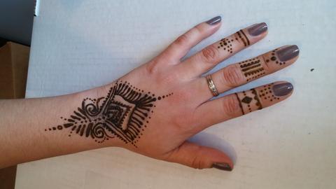 Black jagua tattoo design on hand