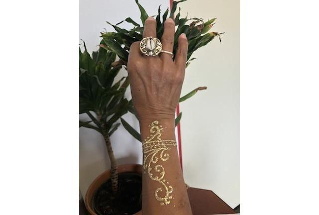 Gold glitter tattoo