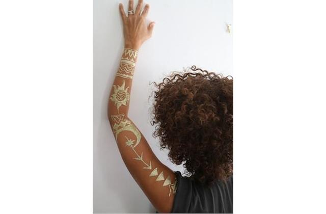 Woman with henna tattoo on arm