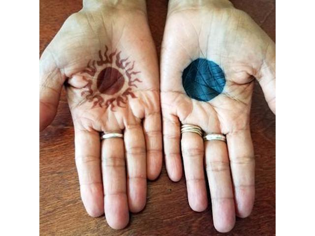 Sun & Moon tatoos on hands
