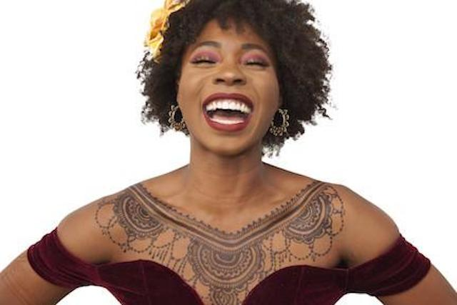 Tamera laughing, with black jagua tattoo