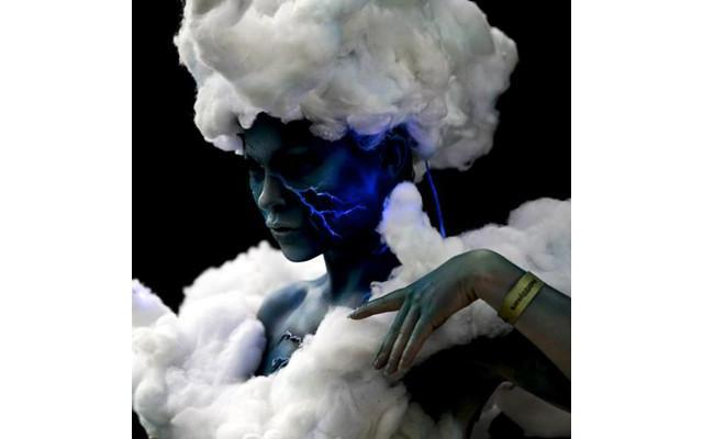 Woman with lightning bolt painted on blue face