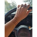 Driving in a Chevy with henna tattoo