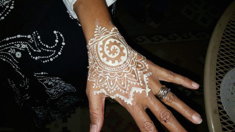 White henna design on hand